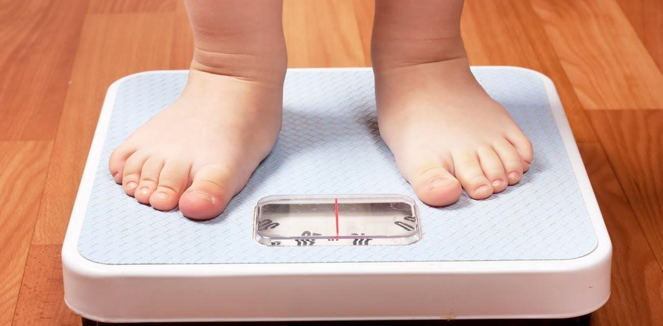 Body image - childs feet standing on scales
